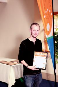Alex Archer with the Spirit of the Fringe award for Buxton Drama League