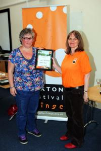 Helen Payne collects the Solo Instrumental Award on behalf of Benjamin Powell