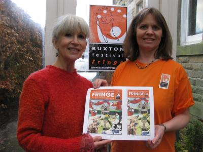 Fringe chair Stephanie Billen (right) congratulates Lynn Hawkins on her winning artwork