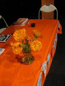 Fringe marigolds adorn the judging table (DO)