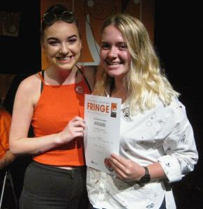 Buxton Community School artists Ceri Davies (left) and Abbie Ingleby (right) pick up their Visual Arts award (credit: Dan Osborne 2018)