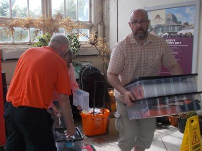 The Fringe committee's Keith, Steph and Stephen helping to pack up the Fringe Desk (SS 2019)