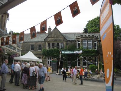 Bunting outside the desk with Underground in the background (and the webmaster in orange) (SB 2019)