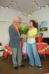 In his final Awards Ceremony as Fringe Chair, Keith Savage receives a bouquet from vice chair Maria Carnegie (credit: Ian J. Parkes)