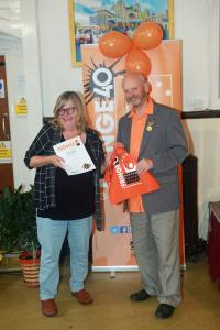 Discover Buxton Tours' Netta Christie receiving the Chair Award from Keith Savage at Fringe40 (credit: Ian J. Parkes)