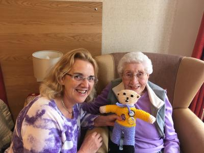 Linda receives a homemade thank you bear from a resident at Haddon Hall.