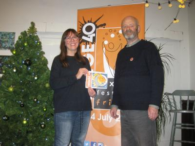 Catherine Webb with her winning design Roar Talent alongside Fringe chair Keith Savage posing at The Green Man Gallery