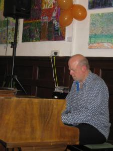 Adrian Lord at the piano.