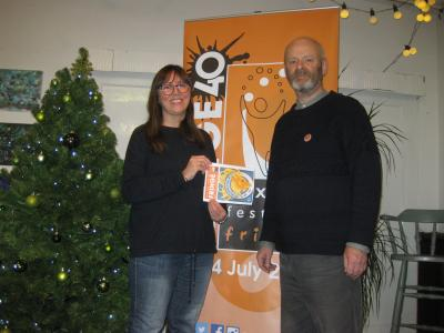 Catherine Webb with her winning artwork for the Fringe 2019 cover alongside Fringe chair Keith Savage posing at the Green Man Gallery