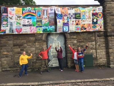 Banners from Two Left Hands' Alternative Well Dressing pictured with Friends of Buxton Station during Fringe 2020 (credit: Two Left Hands)