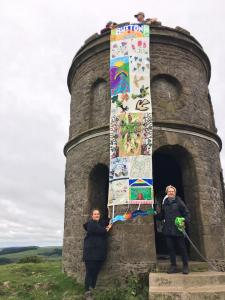 An Alternative Well Dressing banner goes walkies up to Solomon's Temple during Fringe 2020 (credit: Two Left Hands)