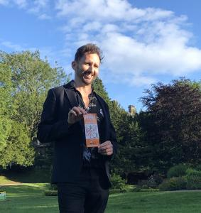 Comedian Nathan Cassidy with Fringe Flyer in the Pavilion Gardens  (credit: Gemma Ball)